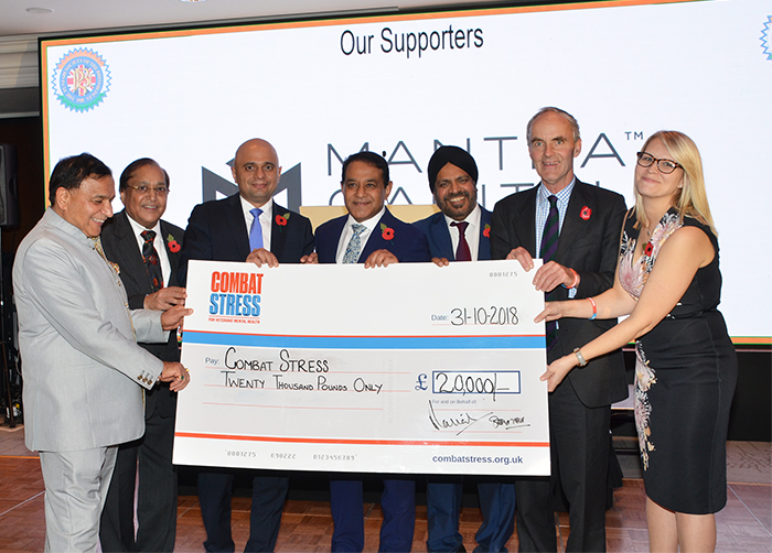 Rt Hon Sajid Javid MP, Home Secretary with the PSBI President Dr Atul Pathak , Vice President , Patrons Dr Rami Ranger CBE and Mr. Anil Sharma and Dr Ravi Gidar presenting the cheque of £20,000 for Combat Stress to Lieutenant General Andrew Graham and Nicola Wearing