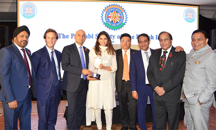 Pride of Punjab Award for Mr. Jasminder Singh OBE, being received by his daughter Krishma Singh from the Home Secretary